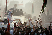 Punjab, Pakistan<br /> November 1988<br /> <br /> Benazir Bhutto campaigning for Prime Miinister.<br /> <br /> Bhutto, the eldest child of former Pakistan President and Prime Minister Zulfikar Ali Bhutto, found herself placed under house arrest in the wake of her father's imprisonment and subsequent execution in 1979. In 1984 she became the leader in exile of the Pakistan Peoples Party (PPP), her father's party, though she was unable to make her political presence felt in Pakistan until after the death of General Muhammad Zia-ul-Haq. ..On 16 November 1988 Benazir's PPP won the largest bloc of seats in the National Assembly. Bhutto was sworn in as Prime Minister in December, at age 35 she became the first woman to head the government of a Muslim-majority state in modern times. <br /> <br /> She was removed from office 20 months later under orders of then-president Ghulam Ishaq Khan for alleged corruption. Bhutto was re-elected in 1993 but was again removed by President Farooq Leghari in 1996, on similar charges. Bhutto went into self-imposed exile in Dubai in 1998, until she returned to Pakistan on October 2007, after General Musharraf granted her amnesty and all corruption charges withdrawn.