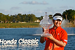 PALM BEACH GARDENS, FL. - Y.E. Yang with the winner's tropy at the 2009 Honda Classic - PGA National Resort and Spa in Palm Beach Gardens, FL. on March 8, 2009.