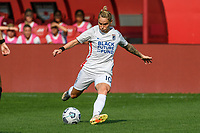 BRIDGEVIEW, IL - JULY 18: Jessica Fishlock #10 of the OL Reign kicks the ball during a game between OL Reign and Chicago Red Stars at SeatGeek Stadium on July 18, 2021 in Bridgeview, Illinois.