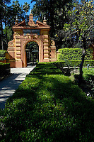 Arched entrance to the gardens of Alcazar of Seville, Andalusia, Spain.