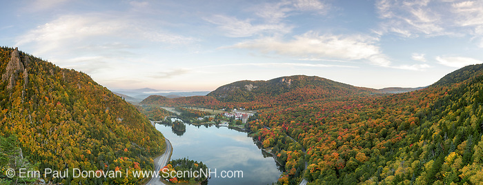 Panoramic of Lake Gloriette in Dixville, New Hampshire USA from a scenic viewpoint along the Sanguinary Ridge Trail during the autumn months. The Balsams Grand Resort is in view. This image consists of five images stitched together