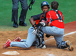 Bronx(NY)'s Samir Portorreal gets tagged at the plate and caught stealing by Mattoon(IL)'s Garrette Branson during the Cal Ripken Babe Ruth World Series in Aberdeen, Maryland on August 12, 2012