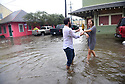 Heavy rains flooded streets in the historic Faubourg Marigny after city pumps were overwhelmed in New Orleans, Sat., Aug. 5, 2017. Tourists staying in Air BnB danced in the flooded streets. (Photo by Cheryl Gerber)