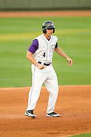 Chris Curley (4) of the Winston-Salem Dash takes his lead off of second base against the Frederick Keys at BB&T Ballpark on May 28, 2013 in Winston-Salem, North Carolina.  The Dash defeated the Keys 17-5 in the first game of a double-header.  (Brian Westerholt/Four Seam Images)