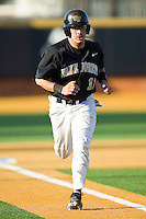 Pat Blair #11 of the Wake Forest Demon Deacons jogs home to score a run against the Miami Hurricanes at Gene Hooks Field on March 19, 2011 in Winston-Salem, North Carolina.  Photo by Brian Westerholt / Four Seam Images