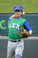 Catcher Cameron Gallagher (25) of the Lexington Legends before a game against the Greenville Drive on Friday, August 18, 2013, at Fluor Field at the West End in Greenville, South Carolina. Gallagher is the No. 15 prospect of the Kansas City Royals and was a second-round pick in the 2011 First-Year Player Draft. Lexington won, 5-0. (Tom Priddy/Four Seam Images)