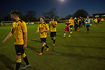 Alvechurch FC 3 Highgate United 0, 26/12/2016. Lye Meadow, Midland Football League Premier Division. The payers leaving the pitch at the final whistle at Lye Meadow as Alvechurch (in amber) hosted Highgate United in a Midland Football League premier division match. Originally founded in 1929 and reformed in 1996 after going bust, the club has plans to move from their current historic ground to a new purpose-built stadium in time for the 2017-18 season. Alvechurch won this particular match by 3-0, watched by 178 spectators, taking them back to the top of the league. Photo by Colin McPherson.