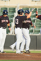 Carl Thomore (13) of the Kannapolis Intimidators gets a high five from a teammate after hitting a grand-slam against the Delmarva Shorebirds at CMC-NorthEast Stadium on July 2, 2014 in Kannapolis, North Carolina.  The Intimidators defeated the Shorebirds 6-4. (Brian Westerholt/Four Seam Images)