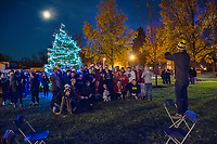 Students at Otterbein University pose in front of the school's Christmas tree after lighting ceremonies under a near full moon.