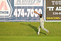 Wilson Tobs left fielder Kevin Jordan #21 (Wake Forest) makes a running catch against the High Point-Thomasville HiToms at Finch Field on June 17, 2013 in Thomasville, North Carolina.  The Tobs defeated the HiToms 3-2 in 11 innings.  Brian Westerholt/Four Seam Images