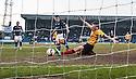 Dundee's Paul McGowan (18) scores their late winning goal.