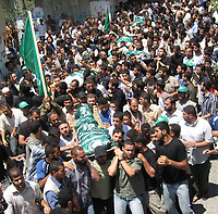 """Palestinians carry bodies of  11 martyrs who killed in the Israeli incursion into the Bureij refugee camp in central Gaza Strip, July 6, 2007 .""""photo by Fady Adwan"""""""