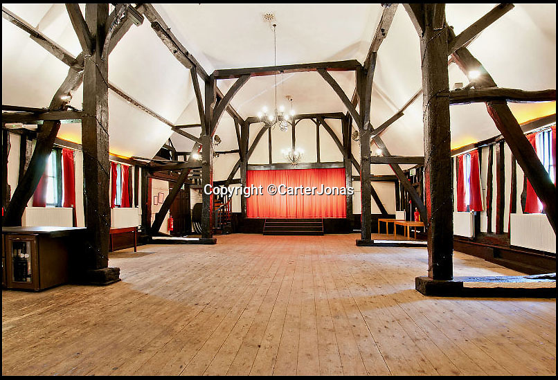 BNPS.co.uk (01202 558833)<br /> Pic: CarterJonas/BNPS<br /> <br /> ***Please Use Full Byline***<br /> <br /> The stage, in the theatre at Little Easton manor. <br /> <br /> <br /> One of Britain's most historic country houses which boasts a theatre that has played host to Charlie Chaplin and H.G. Wells has gone on the market with a £5 million price tag.<br /> <br /> In the early 1900s the sprawling estate's tithe barn was transformed into a theatre in which the great and the good of the acting world flocked to perform.<br /> <br /> Edwardian actress Ellen Terry gave poetry readings there while War of the Worlds author H.G. Wells, who lived with his family in a house on the estate, also frequented the theatre.<br /> <br /> Other regular performers included Charlie Chaplin, Gracie Fields and George Formby.<br /> <br /> In more recent years it has welcomed famous faces such as Rowan Atkinson, Bill Cotton, Tim Rice, Esther Rantzen and even the cast of Eastenders.<br /> <br /> The 17th century Grade II listed manor is on the market with Carter Jonas estate agents for £5 million.