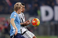 Calcio, Serie A: Lazio vs Juventus. Roma, stadio Olimpico, 4 dicembre 2015.<br /> Lazio's Dusan Basta, left, and Juventus' Alex Sandro fight for the ball during the Italian Serie A football match between Lazio and Juventus at Rome's Olympic stadium, 4 December 2015.<br /> UPDATE IMAGES PRESS/Riccardo De Luca
