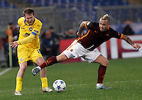 Calcio, Champions League: Gruppo E - Roma vs Bate Borisov. Roma, stadio Olimpico, 9 dicembre 2015.<br /> Bate Borisov's Aleksandr Hleb, left, is challenged by Roma's Radja Nainggolan during the Champions League Group E football match between Roma and Bate Borisov at Rome's Olympic stadium, 9 December 2015.<br /> UPDATE IMAGES PRESS/Isabella Bonotto