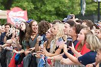NASHVILLE, TN - SEPTEMBER 5: Fans listen to Ben Rector perform at US Soccer FanHQ at Nissan Stadium on September 5, 2021 in Nashville, Tennessee.