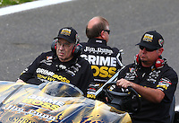 May 31, 2014; Englishtown, NJ, USA; Jim Dunn owner and crew chief of the car driven by NHRA funny car driver Jeff Arend during qualifying for the Summernationals at Raceway Park. Mandatory Credit: Mark J. Rebilas-
