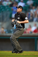 Umpire Scott Costello gets in position during a game between the Corpus Christi Hooks and Arkansas Travelers on May 29, 2015 at Dickey-Stephens Park in Little Rock, Arkansas.  Corpus Christi defeated Arkansas 4-0 in a rain shortened game.  (Mike Janes/Four Seam Images)