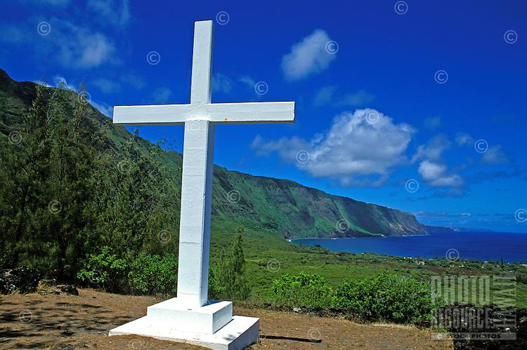 A large white cross overlooks the sea at the historic Kalaupapa Leprosy Settlement on the island of Molokai.
