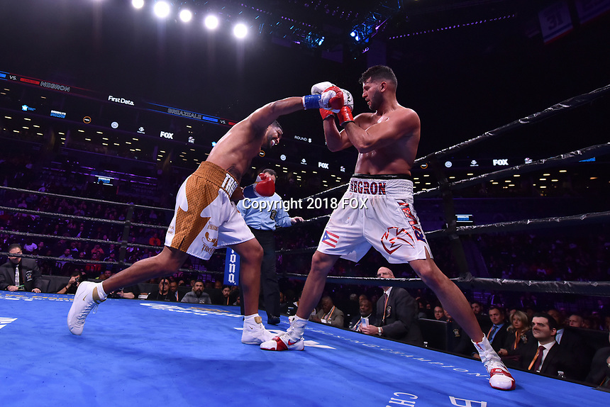 """BROOKLYN, NY - DECEMBER 22: (L-R) Boxers Dominic Breazeale fights Carlos Negron during their Heavyweight match at the Fox Sports and Premier Boxing Champions  December 22 """"PBC on Fox"""" Fight Night at the Barclays Center on December 22, 2018 in Brooklyn, New York. (Photo by Anthony Behar/Fox Sports/PictureGroup)"""