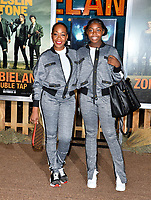 """LOS ANGELES, USA. October 11, 2019: Tichina Arnold & Alijah Kai Haggins at the premiere of """"Zombieland: Double Tap"""" at the Regency Village Theatre.<br /> Picture: Paul Smith/Featureflash"""