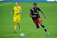 WASHINGTON, DC - OCTOBER 28: Donovan Pines #23 of D.C. United plays the ball during a game between Columbus Crew and D.C. United at Audi Field on October 28, 2020 in Washington, DC.