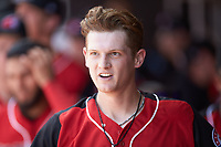 Sam Huff (24) of the Hickory Crawdads in the home dugout after hitting a home run against the Lakewood BlueClaws at L.P. Frans Stadium on April 28, 2019 in Hickory, North Carolina. The Crawdads defeated the BlueClaws 10-3. (Brian Westerholt/Four Seam Images)