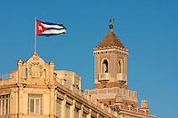 Cuba, Havana.  Cuban Flag, Bacardi Building in Background.