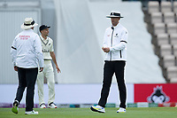 Michael Gough, Umpire and Richard Illingworth, Umpire consult about the light and take the players off for an early tea during India vs New Zealand, ICC World Test Championship Final Cricket at The Hampshire Bowl on 19th June 2021