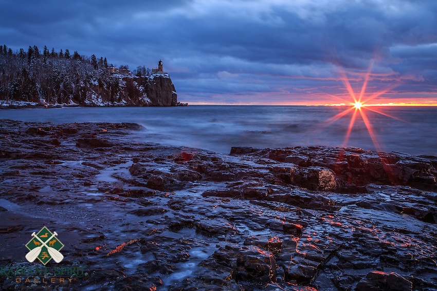 """""""Daybreak at Split Rock Lighthouse""""<br /> The transition from twilight to sunrise can be dramatic and rich with color and texture. While Mother Nature painted the stunning canvas, the gentle waves of Lake Superior provided the perfect accompaniment. We found great inspiration in our experience at Split Rock Lighthouse, and it was the perfect beginning to our North Shore adventure.<br /> <br /> We are reminded to remain present, because these moments are fleeting; conditions change quickly and the artistic creations have soon passed. We are grateful to preserve those moments from nature through photography and videography."""