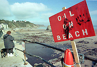 """Pictured: """"Oil On Beach"""" warning sign in Tenby, Pemrokeshire<br /> Re: The Sea Empress oil spill occurred at the entrance to the Milford Haven Waterway in Pembrokeshire, Wales on 15th February 1996 which was followed up by a clean up operation has begun"""