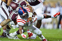 Ole Miss running back Jaylen Walton (6) is brought down by Texas A&M defensive lineman Myles Garrett (15) during second half of an NCAA football game, Saturday, October 11, 2014 in College Station, Tex. Ole Miss defeated Texas A&M 35-20. (Mo Khursheed/TFV Media via AP Images)