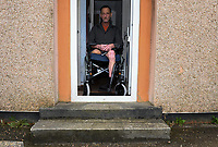 Pictured is amputee, Lyn Powell, who claims he is trapped inside his own home to access difficulties to the property in Heol Hen, Seven Sisters, Wales, UK