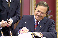 FILE PHOTO March 8 2001 Quebec, Canada<br /> <br /> Jacques Brassard get sworn in as Minister during the presentation of Bernard Landry (L) new cabinet, March 8 2001, at the National Assembly, in Quebec City.