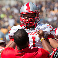 New Mexico safety Dante Caro (31) celebrates with a coach after intercepting a pass. The Pitt Panthers defeated the New Mexico Lobos 49-27 on Saturday, September 14, 2013 at Heinz Field, Pittsburgh, Pennsylvania.