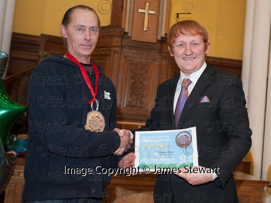 "Litter Strategy Awards 2013 : Councillor Craig R Martin presents the ""Wow Factor"" award to Charlie Penn."