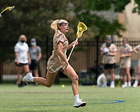NEWTON, MA - MAY 16: Belle Smith #5 of Boston College brings the ball forward during NCAA Division I Women's Lacrosse Tournament second round game between Temple University and Boston College at Newton Campus Lacrosse Field on May 16, 2021 in Newton, Massachusetts.