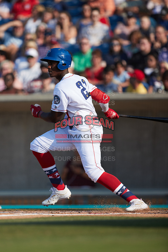 Luis Mieses (21) of the Kannapolis Cannon Ballers follows through on his swing against the Charleston RiverDogs at Atrium Health Ballpark on July 4, 2021 in Kannapolis, North Carolina. (Brian Westerholt/Four Seam Images)
