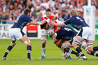 Japan Number 8 Amanaki Mafi is tackled by Scotland Lock Grant Gilchrist - Mandatory byline: Rogan Thomson - 23/09/2015 - RUGBY UNION - Kingsholm Stadium - Gloucester, England - Scotland v Japan - Rugby World Cup 2015 Pool B.