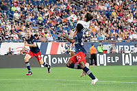 FOXOBOROUGH, MA - AUGUST 21: Florian Valot #64 of FC Cincinnati chest traps the ball near the New England Revolution goal during a game between FC Cincinnati and New England Revolution at Gillette Stadium on August 21, 2021 in Foxoborough, Massachusetts.