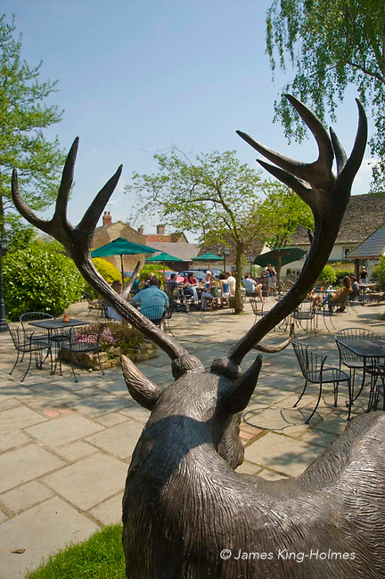 In the garden of the 15th century White Hart public house in Fyfield, Oxfordshire the bronze statue of a hart - the medieval name for a white stag - appears to watch the customers enjoying their drinks and food.