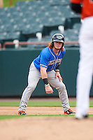Akron RubberDucks left fielder Clint Frazier (4) leads off first during the first game of a doubleheader against the Bowie Baysox on June 5, 2016 at Prince George's Stadium in Bowie, Maryland.  Bowie defeated Akron 6-0.  (Mike Janes/Four Seam Images)