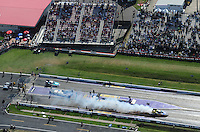 Apr. 28, 2012; Baytown, TX, USA: Aerial view of NHRA funny car driver Jim Head does a burnout during qualifying for the Spring Nationals at Royal Purple Raceway. Mandatory Credit: Mark J. Rebilas-