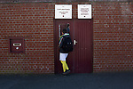 Arbroath 0 Edinburgh City 1, 15/03/2017. Gayfield Park, SPFL League 2. A young home fan outside the players' entrance at Gayfield Park before Arbroath hosted Edinburgh City in an SPFL League 2 fixture. The newly-promoted side from the Capital were looking to secure their place in SPFL League 2 after promotion from the Lowland League the previous season. They won the match 1-0 with an injury time goal watched by 775 spectators to keep them 4 points clear of bottom spot with three further games to play. Photo by Colin McPherson.