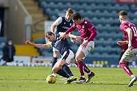 13th March 2021; Dens Park, Dundee, Scotland; Scottish Championship Football, Dundee FC versus Arbroath; Paul McGowan of Dundee challenges for the ball with Michael McKenna of Arbroath