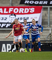 7th February 2021; Leigh Sports Village, Lancashire, England; Women's English Super League, Manchester United Women versus Reading Women; Ivana Fuso of Manchester United Women under pressure from Jess Fishlock of Reading