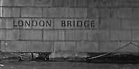 A view under the London Bridge at the name in B&W