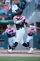 Ti'Quan Forbes (10) of the Charlotte Knights follows through on his swing against the Gwinnett Stripers at Truist Field on July 17, 2021 in Charlotte, North Carolina. (Brian Westerholt/Four Seam Images)
