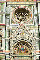 Theright door mosaic and the fine Gothic architectural detail and Rose window of  the  of the Gothic-Renaissance Duomo of Florence,  Basilica of Saint Mary of the Flower; Firenza ( Basilica di Santa Maria del Fiore ).  Built between 1293 & 1436. Italy