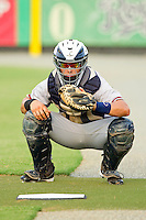 Danville Braves catcher Nick DeSantiago (33) warms up the pitcher in the bullpen prior to the game against the Burlington Royals at Burlington Athletic Park on July 18, 2012 in Burlington, North Carolina.  The Royals defeated the Braves 4-3 in 11 innings.  (Brian Westerholt/Four Seam Images)